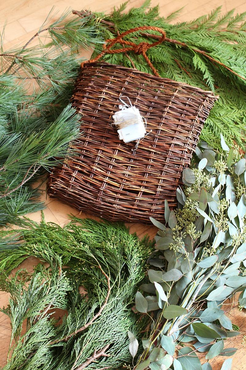 Fresh greenery for Christmas basket wreath.