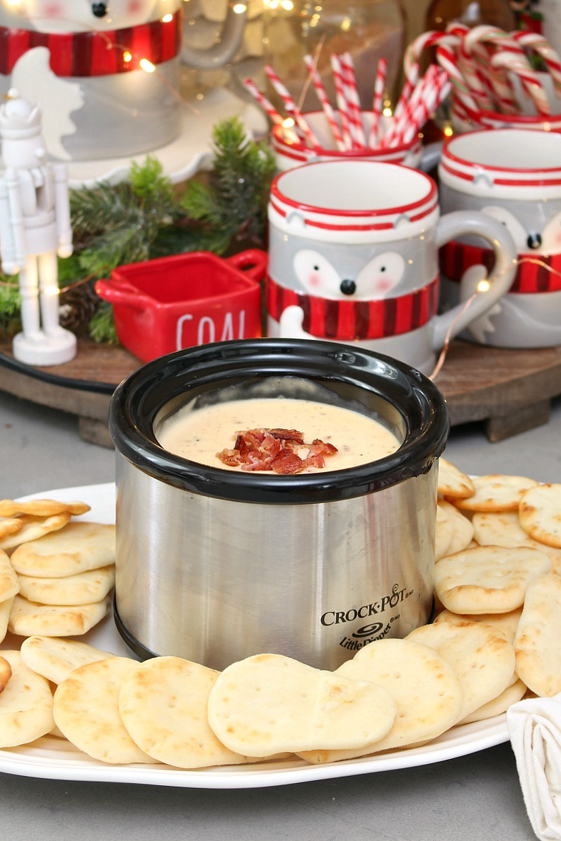 Swiss cheese, bacon, and beer dip in a mini crock pot.