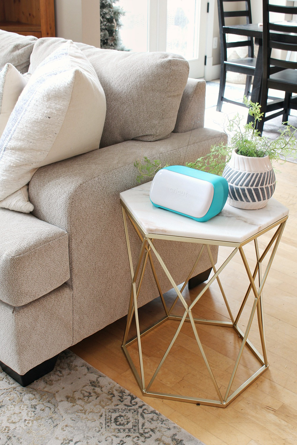 Cricut Joy smart cutting tool on a side table in a family room.