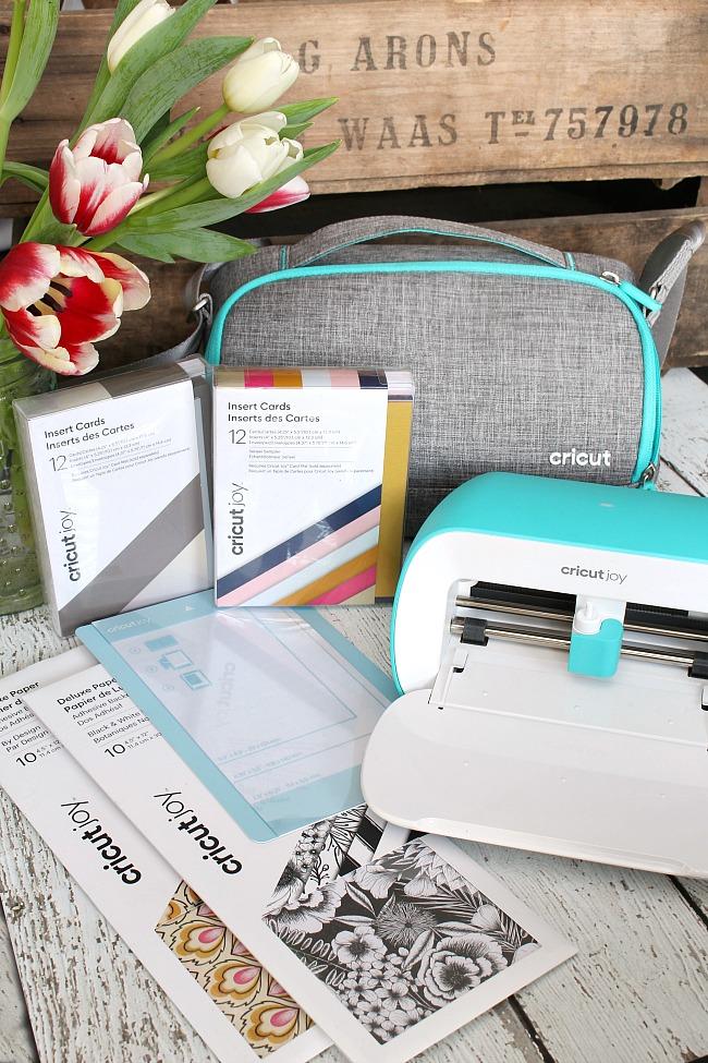 Cricut Joy smart cutter and card accessories.