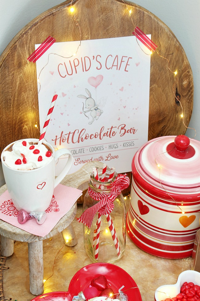 Adorable hot chocolate bar idea with free Cupid's Cafe printable.