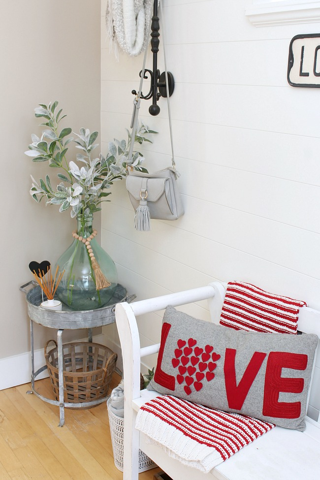 Front entry bench with Love Valentine's Day pillow.