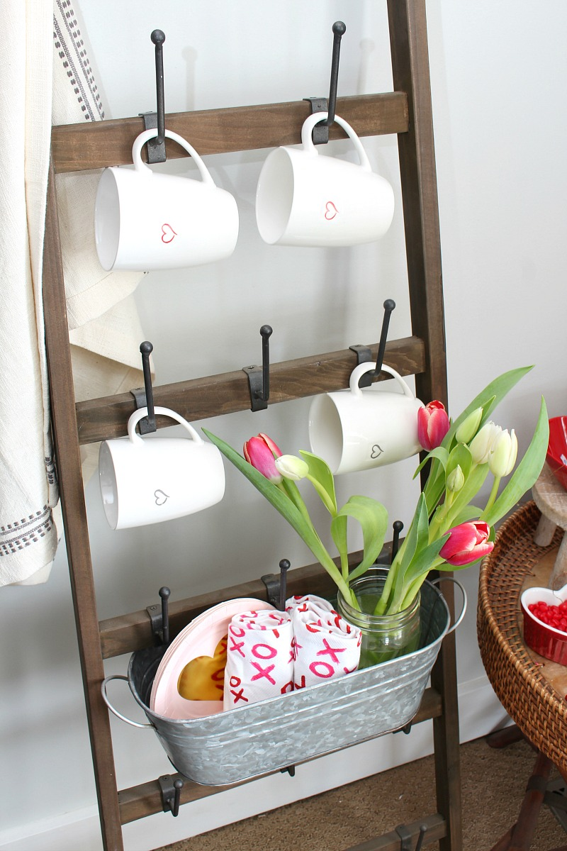 Valentine's Day hot chocolate bar with mug ladder for mugs and other supplies.