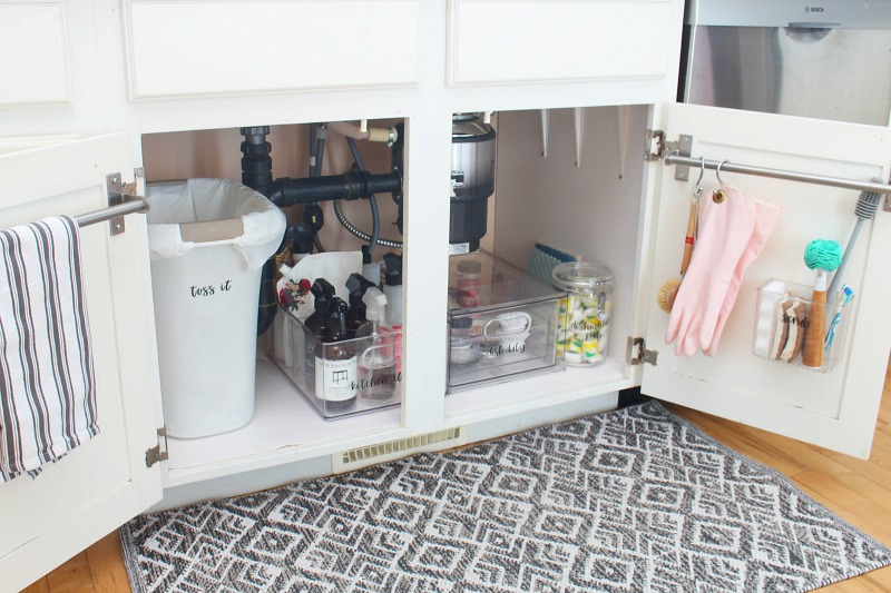 Organized space under the kitchen sink.