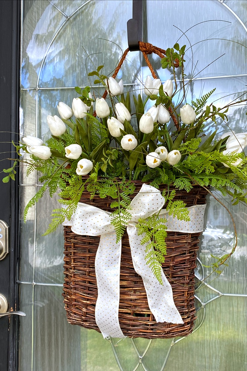 Spring basket tulip wreath with ribbon.