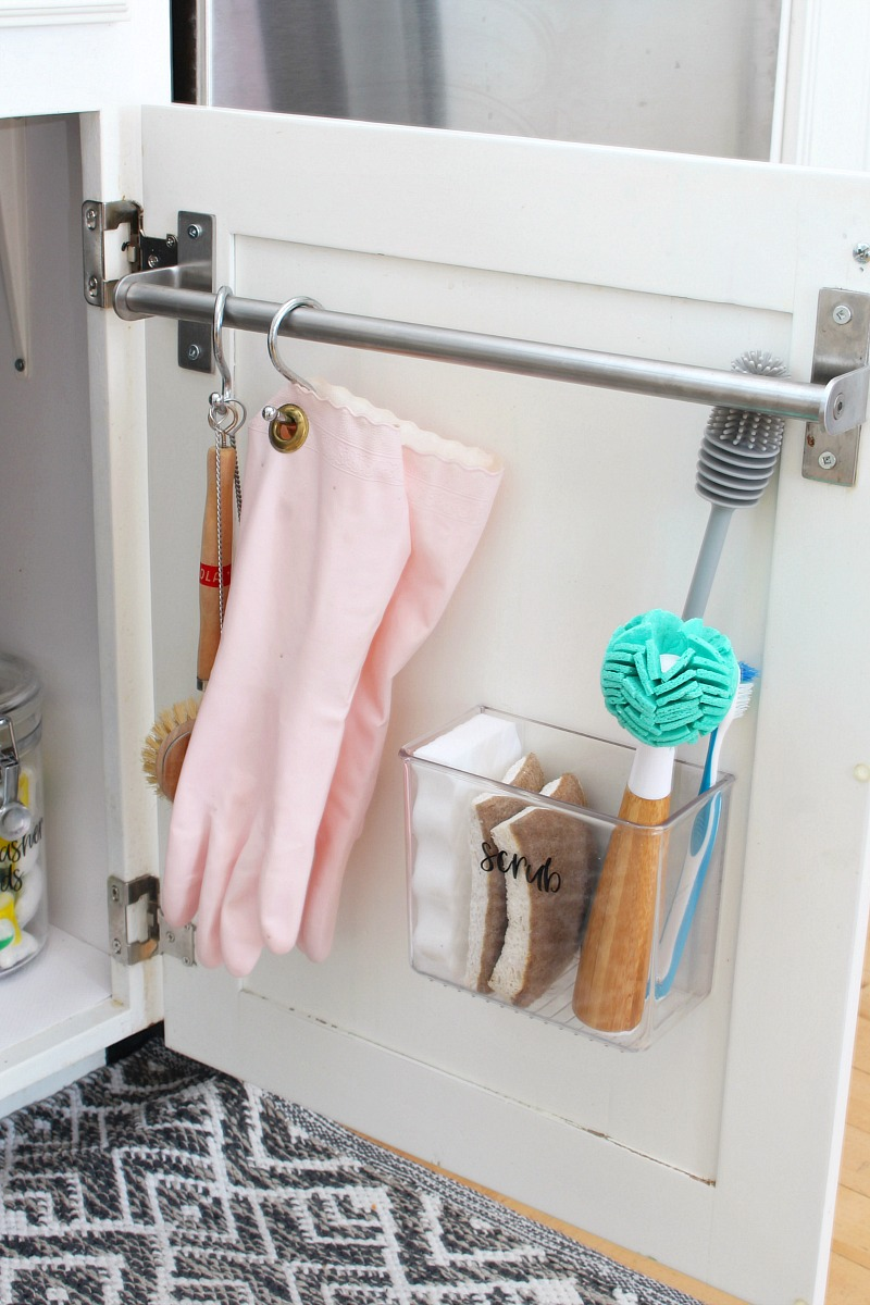 Inside of kitchen cupboard used for extra storage for cleaning products.