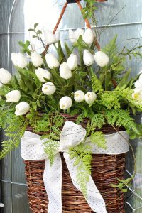 Pretty tulip wreath in a willow basket with gold polka dot ribbon.