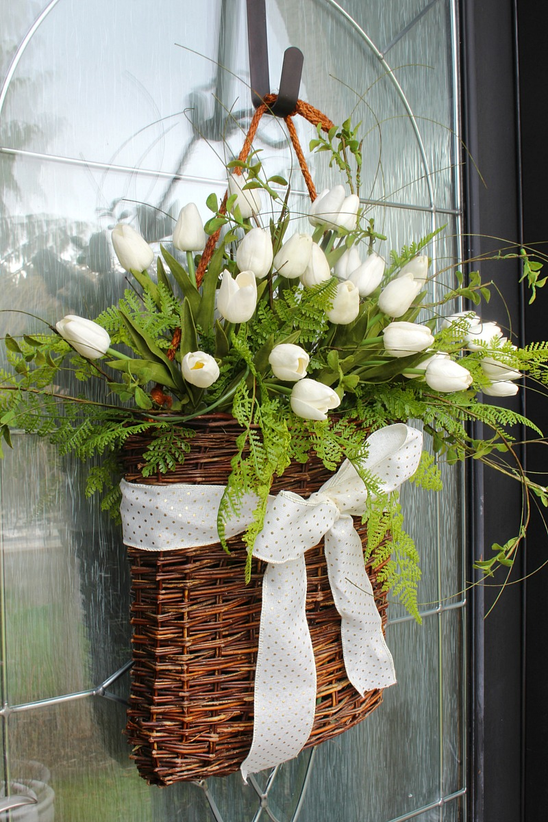 Pretty basket tulip wreath on a front door.