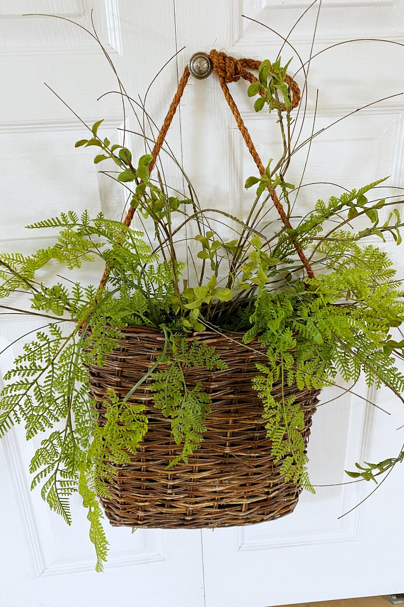 Faux greenery in a willow basket.