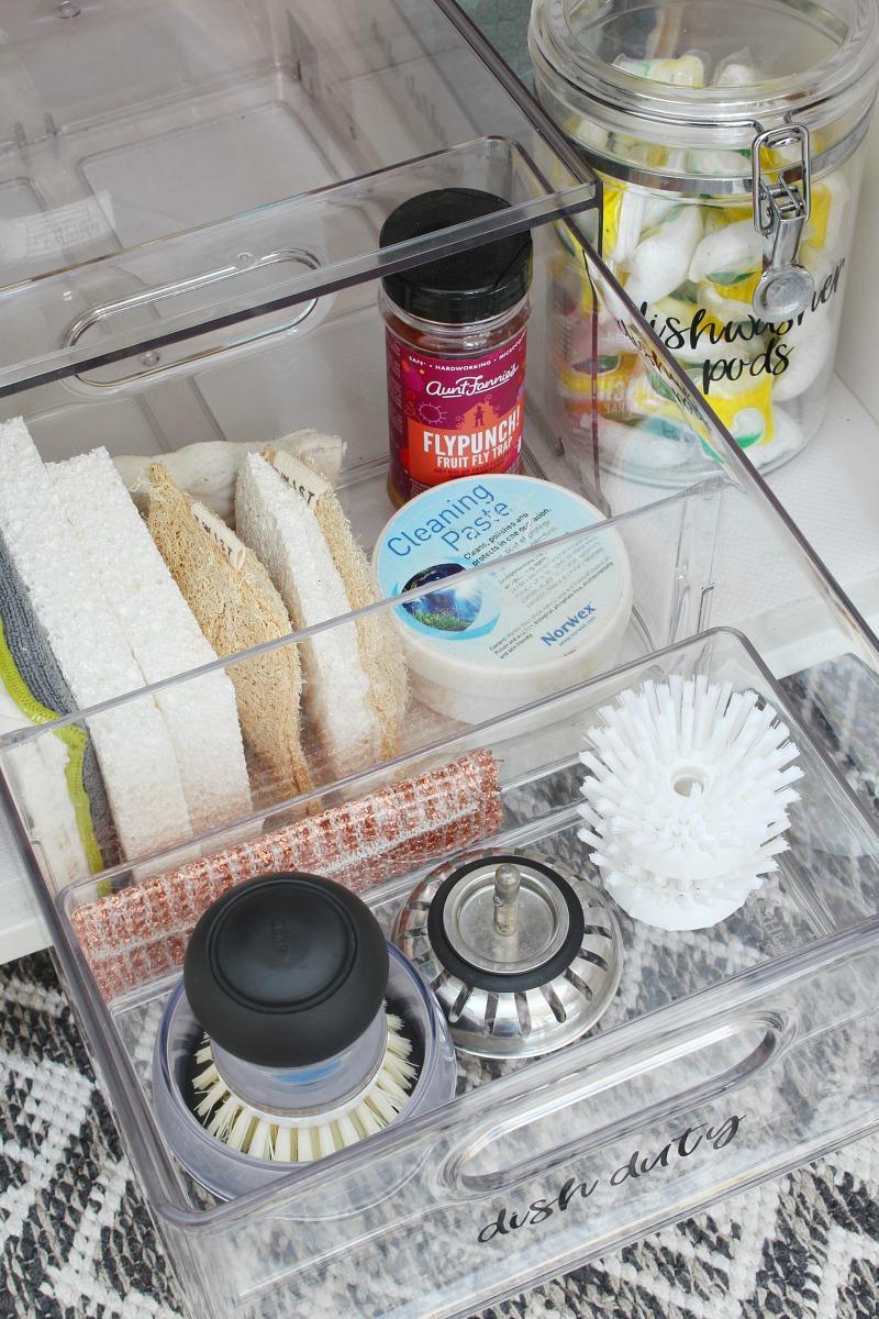 Acrylic drawer organizer for under the kitchen sink.
