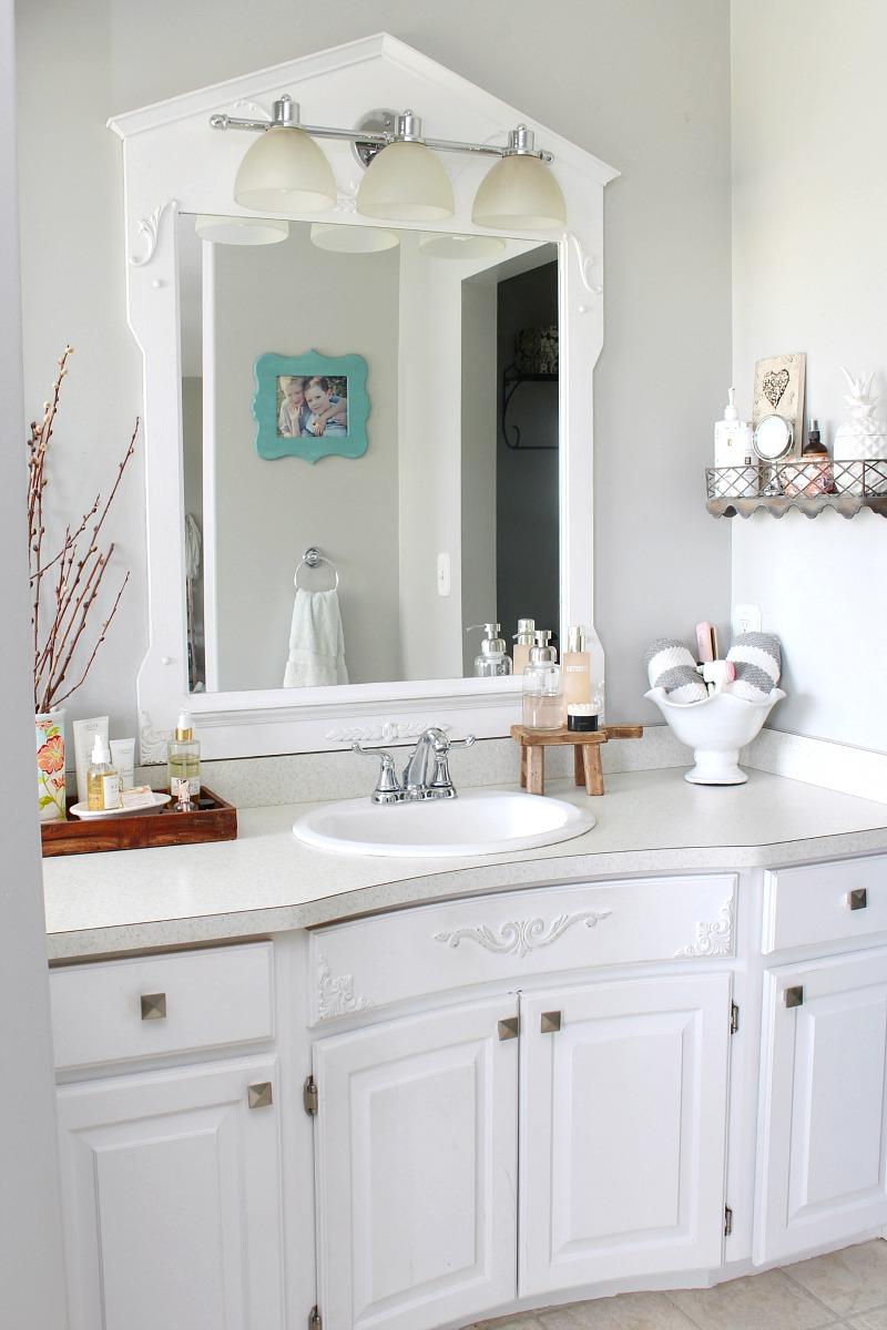 Organized white master bathroom.
