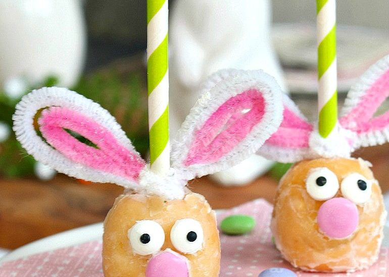 Cute Easter bunny donut holes on a cake stand.