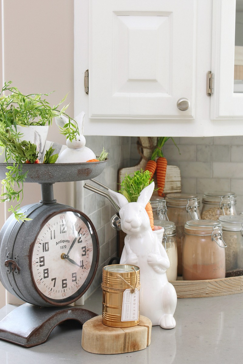 Easter decor using greenery and a white ceramic bunny.