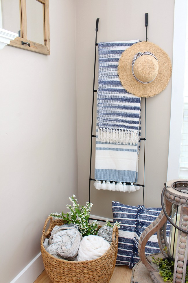 Blanket ladder with blue and white throw blankets.