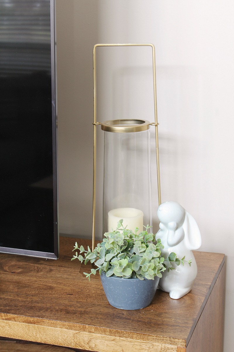 Simple Easter decor with white bunny and gold lantern.