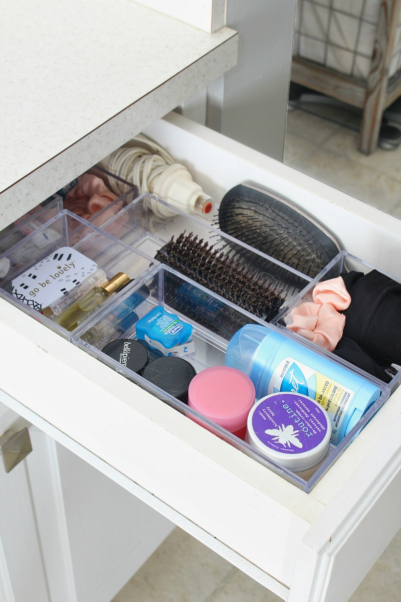 Bathroom drawer organization using stackable acrylic bins.