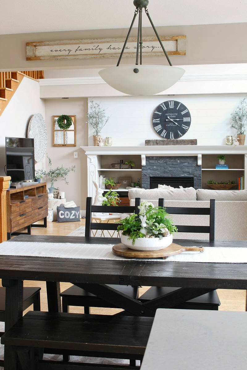 Farmhouse style kitchen table looking into the family room.