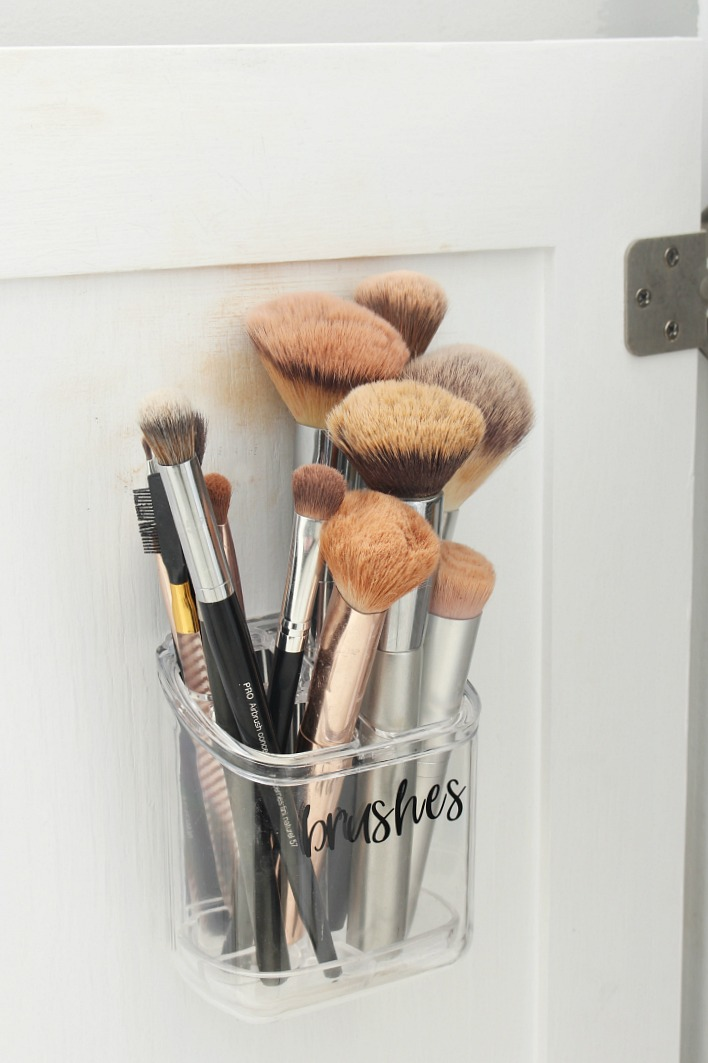 Make-up brush organizer to hang on the cabinet door.