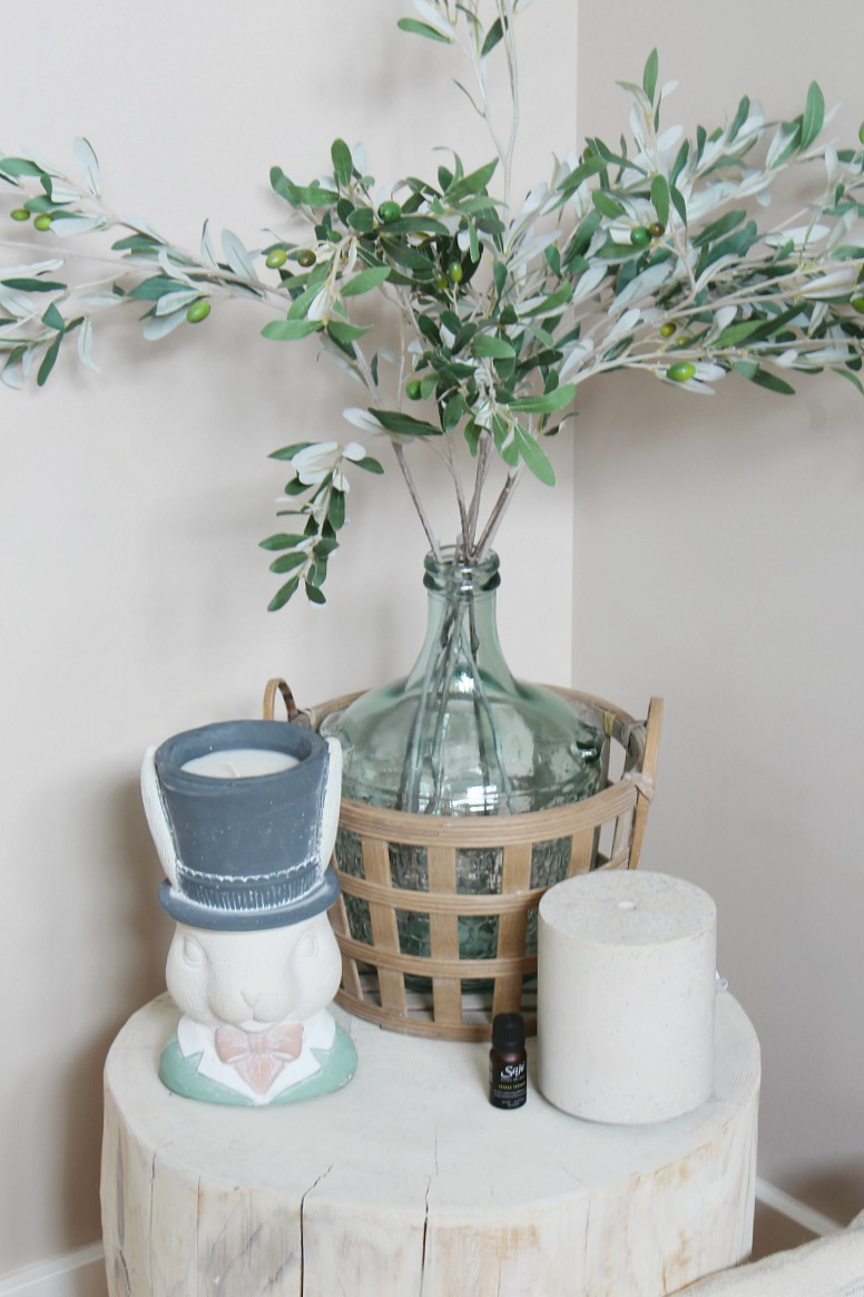 Simple spring decor ideas with olive branches and bunny candle.