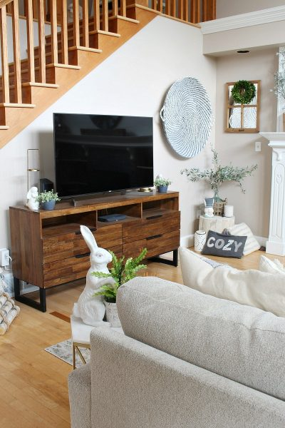 Transitional style family room with television console. #familyroom #familyroomdecor #televisionstand #springdeecor