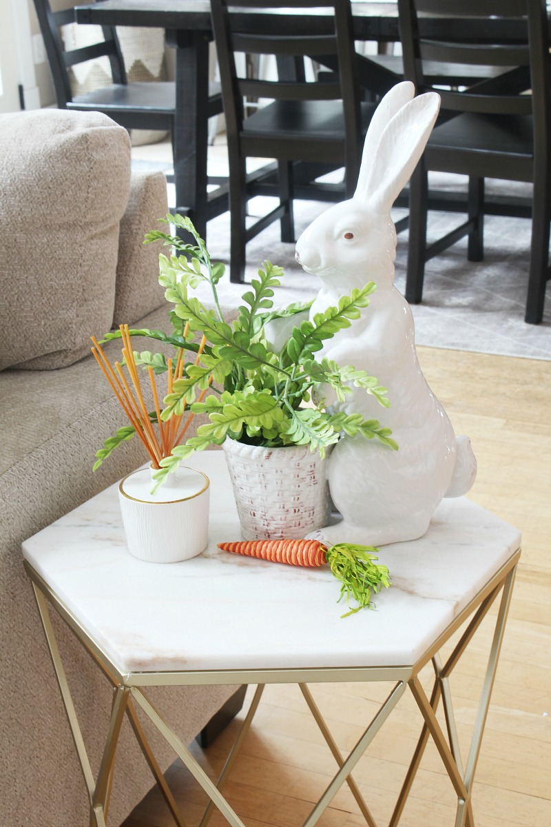 Gold and marble side table with spring vignette.