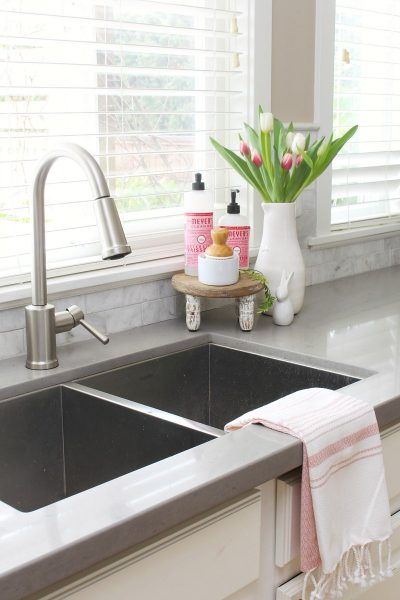 Pretty kitchen sink and garbage disposal.