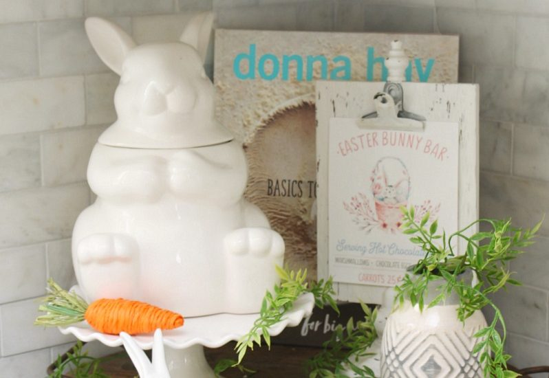 Wood tray with Easter kitchen decor items in a white kitchen.
