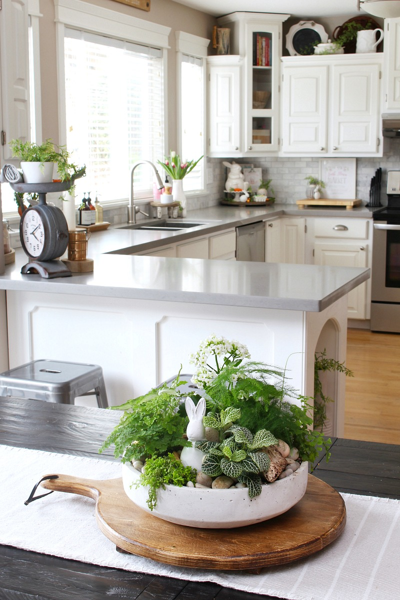White farmhouse style kitchen decorated for spring.