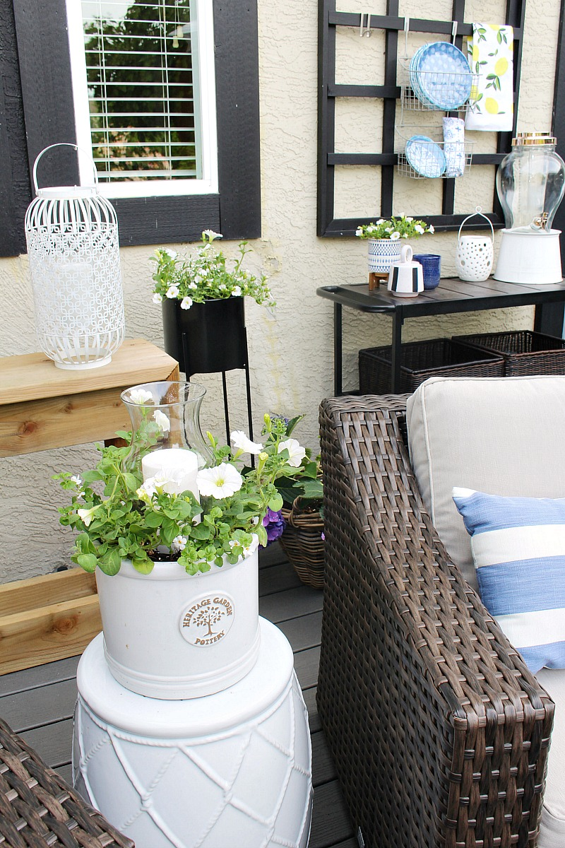 DIY outdoor planter with candle on a summer patio.