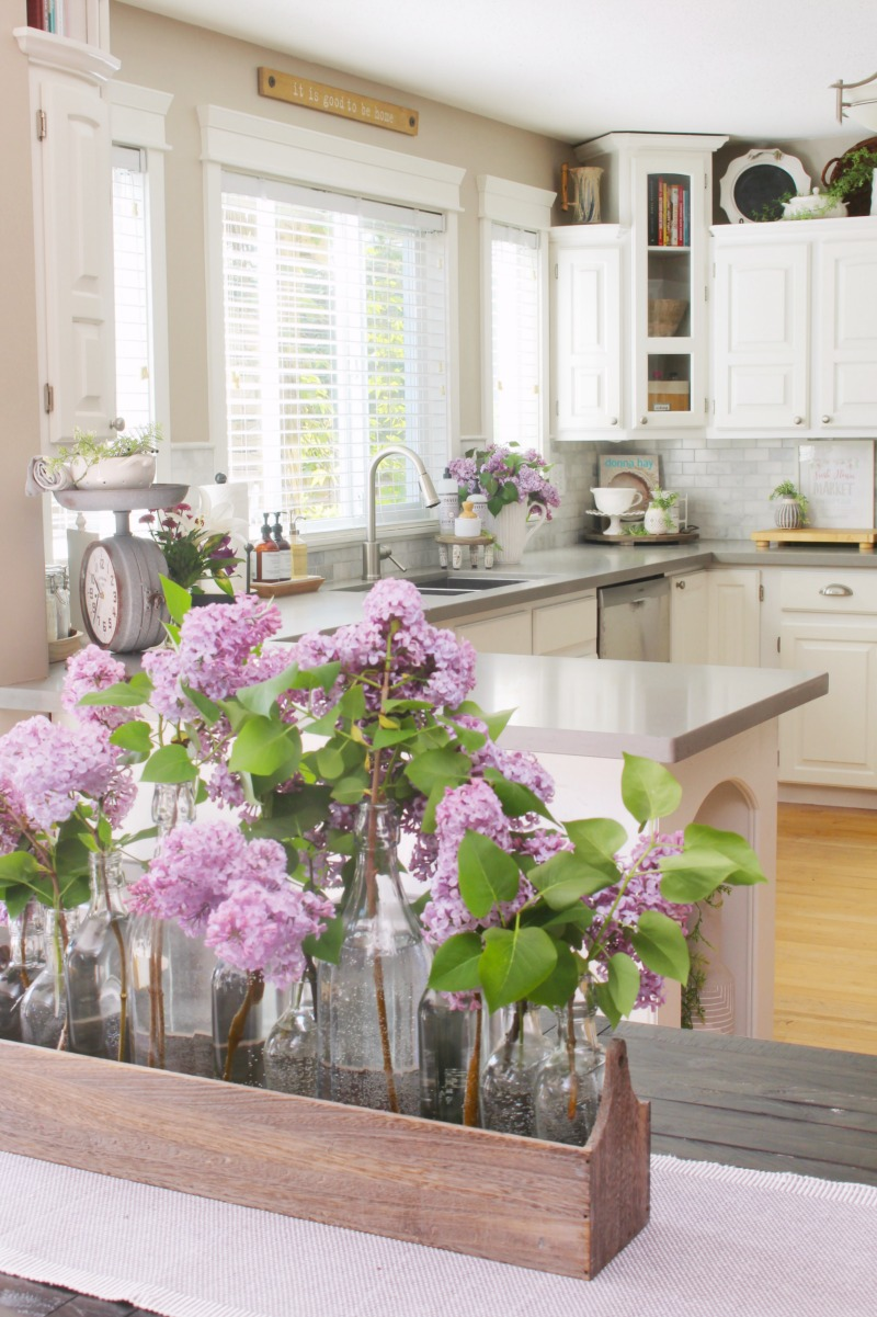 Fresh lilacs used as a centerpiece on a kitchen table.