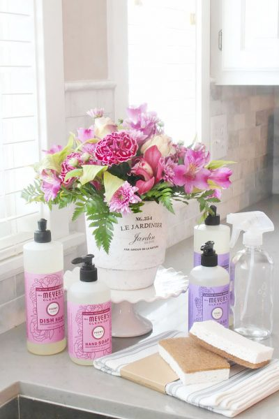 Spring cleaning supplies with flowers.