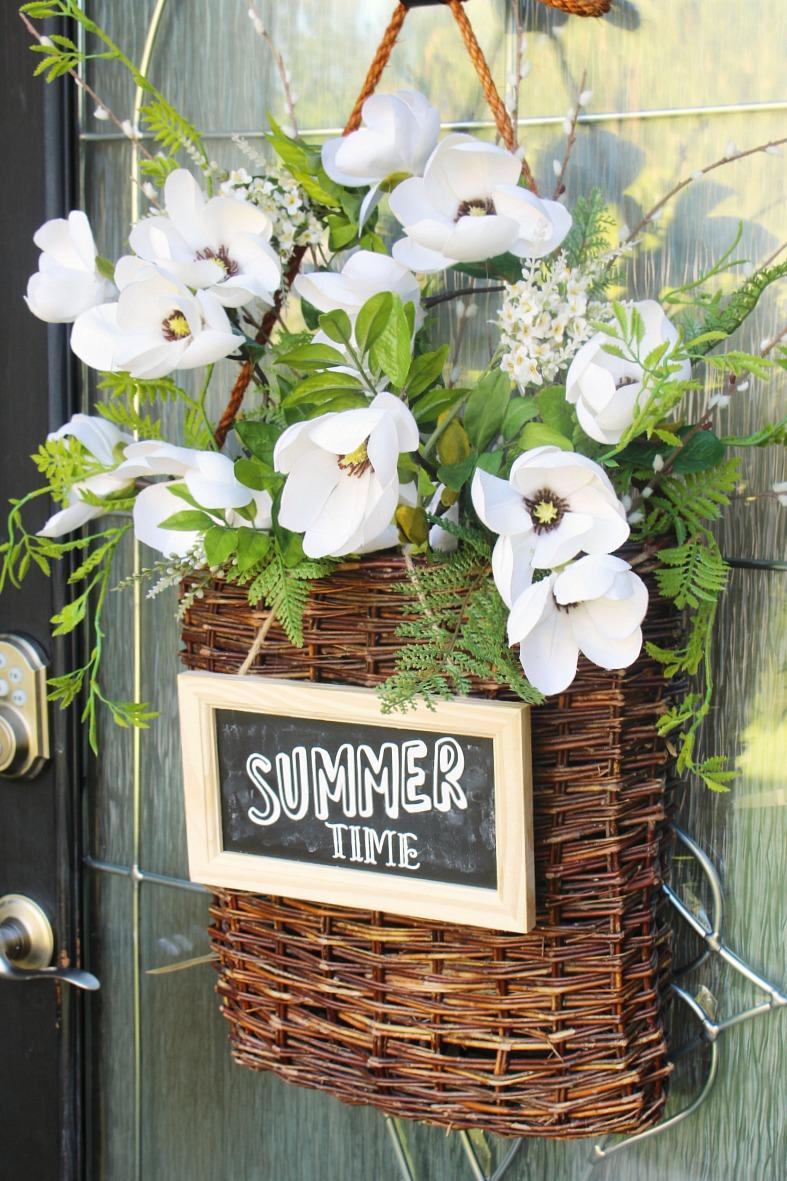 Summer basket wreath on a front door.