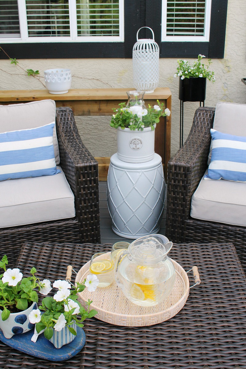 DIY flower planter candle holder on a summer patio.