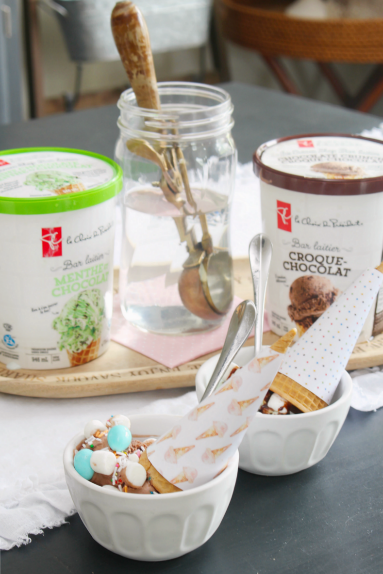 Ice cream sundae bar with free printable ice cream cone wrappers.