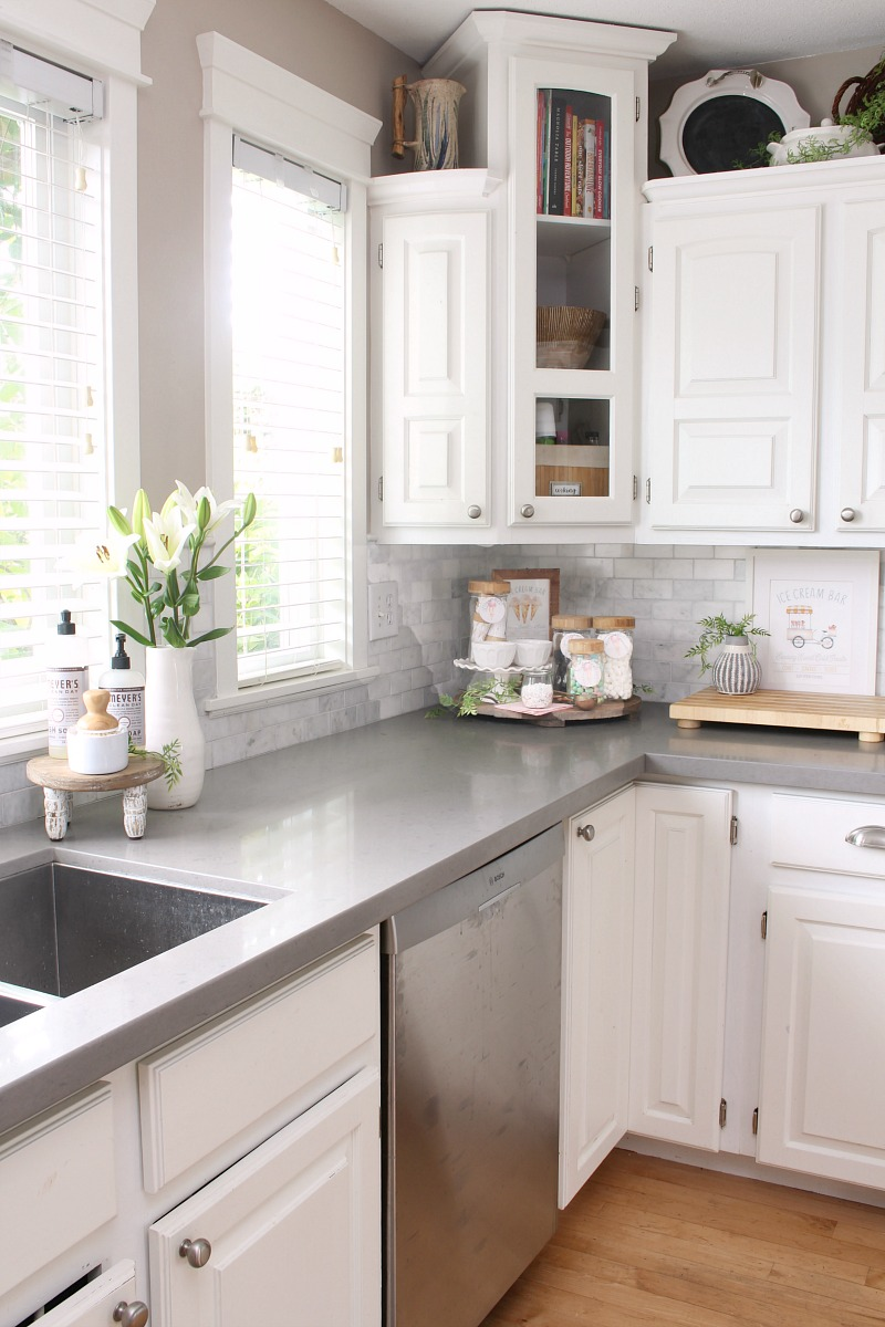 White farmhouse style kitchen decorated for summer with an ice cream sundae bar.