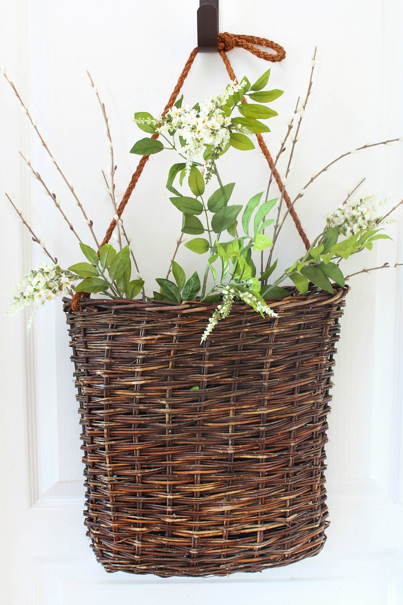 Summer basket wreath tutorial step 1 . Basket with greenery.