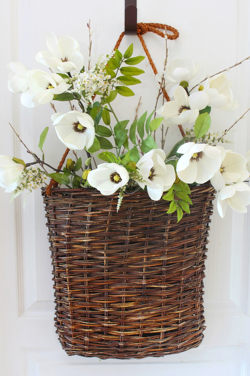 Summer basket wreath tutorial step 2. Basket with greenery and flowers.