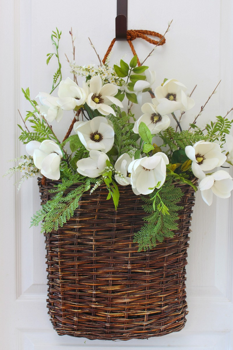 Summer basket wreath tutorial step 3. Basket with flowers and greenery.