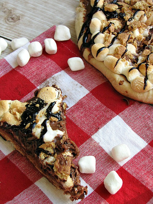 S'mores pizza on a red check tablecloth.