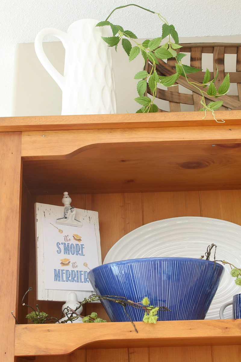 Summer hutch decorated with blue and white.