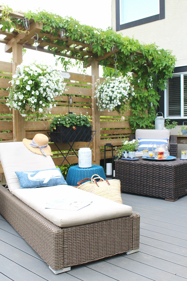 Beatiful summer patio with Trex decking and white flowers.