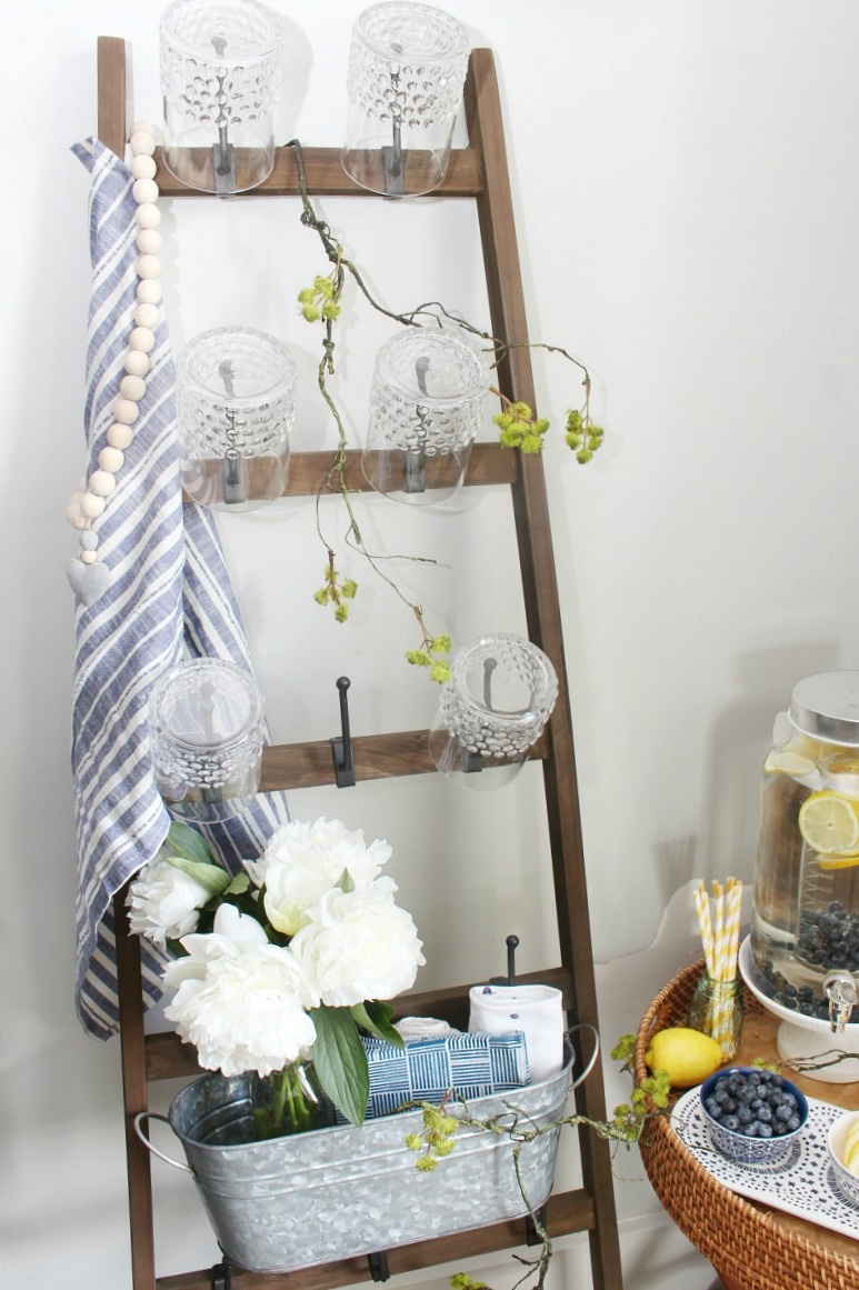 Wall ladder with cups for a beverage bar.
