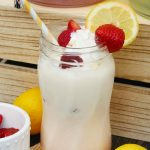 Strawberry lemonade float with fresh strawberries and lemonades.