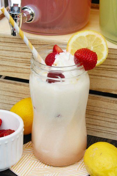 Strawberry lemonade float with fresh strawberries and lemonades.