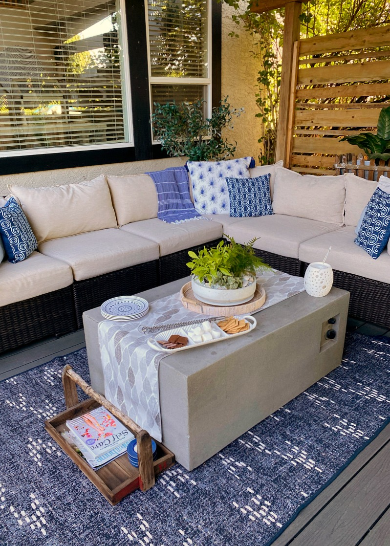 Outdoor sectional in a covered outdoor patio.