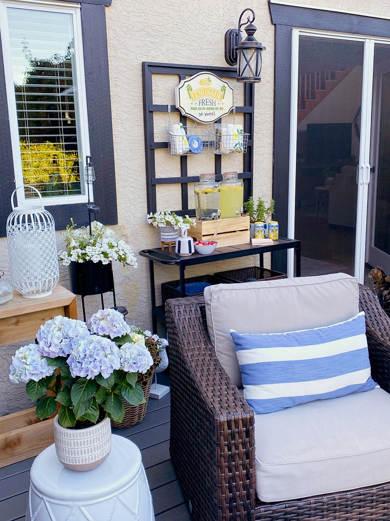 Outdoor patio with club house chairs and beverage bar.