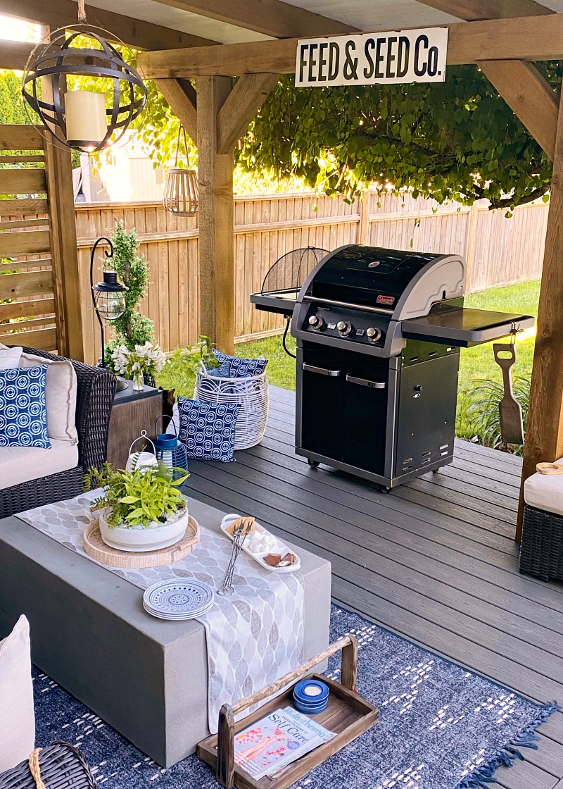 Covered outdoor patio with BBQ area.