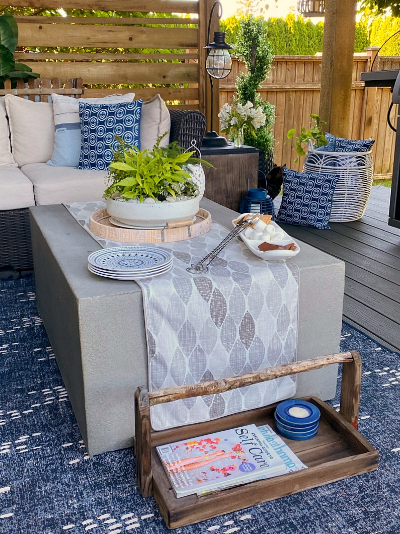 Covered outdoor patio table with fire table.