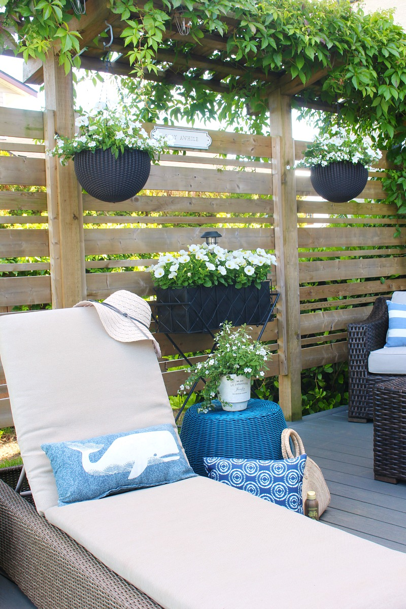 Beautiful outdoor patio with wood privacy screen.