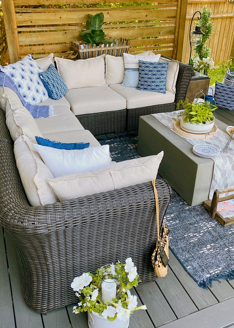 Outdoor sectional in a covered backyard patio.